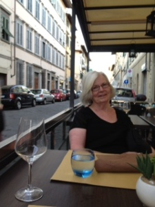 "Ann relaxing at our ""local"" in Florence at the end of a month of sweltering heat in  Italy. We spent each evening here in Florence recreating ourselves!"