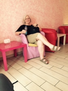 Ann enjoying lunch in Naples in an upstairs boudoir up a 12 inch wide stairway BUT it was air conditioned and we were the only ones there! Magic!