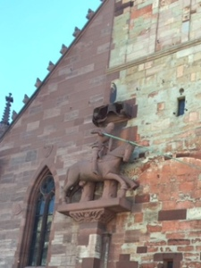 Death of the dragon on front wall of Basel Cathedral