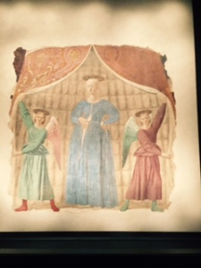 This is the only painting of a pregnant Mary, mother of Christ I have seen. Her demeanour is very serious indeed and the angels are curiously identical. It is typical of Piero della Francesca's unique way of seeing his subjects.