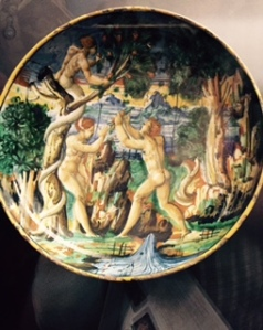 an early porcelain plate from the Fredi collection which shows an Eden scene with the serpent actually shaking the fruit free from the tree of the knowledge of good and evil!
