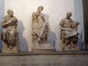 Signed Michelangelo sculpture (middle statue) in the New Sacristy of the Medici Chapels in San Lorenzo Florence. Vasari put these statues over the very plain tomb of the Duke of Urbino (Lorenzo the Magnificent's grandson)