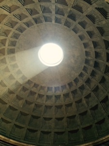 The Pantheon under the dome which is open to the weather. The marble floor has large holes in several places to allow the water to drain when it rains.