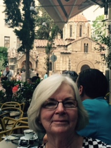 """Each evening we had a meal at our """"local"""", The Collage restaurant (actually the menu was all Italian!);  We sat outside in full view of this wonderful small Greek Orthodox church ..a standard style repeated throughout Greece (on the islands with white walls and blue domes!)."""