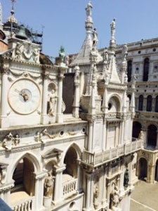 Ancient clock and statuary inside the Doge's Palace Venice from the 4th floor