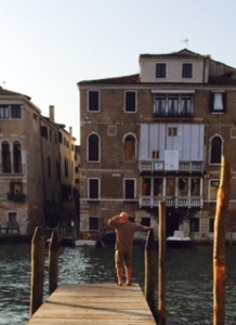 Richard looking for his private motor launch to arrive on the Grand Canal in Venice