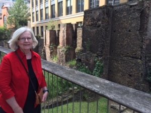 Ann in front of ancient Roman walls in London revealed recently after excavations for a new building
