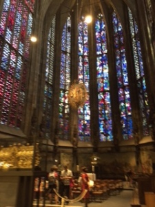 C15th Gothic choir with very high stained glass windows reminiscent of San Chapelle in Paris. The glass was bombed out in WW11 so the glass is relatively new and gleaming