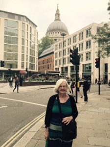 Ann hugging up in London's 19 degree Summer rainy day with St Paul's in the distance