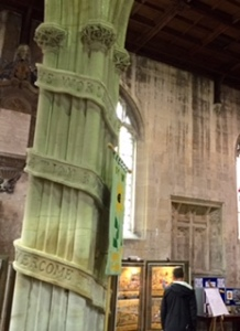Unusual pillars in Holy Trinity Anglican church in Bradford on Avon containing well known Bible verses scrolled around