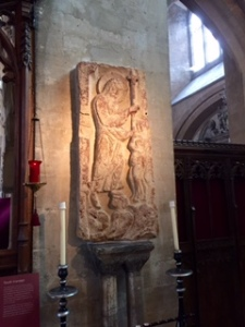 Ancient Saxon stone carving of the Harrowing of Hell, Christ saving Adam and Eve representing all humanity in Bristol Cathedral