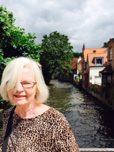 Ann by one of the many very scenic canals in Bruges