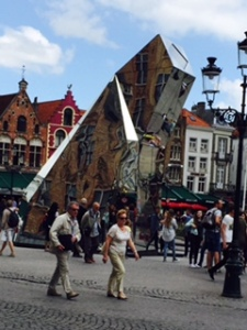 Bruges Markt Square..a modern installation against ancient guild houses and many tourists!