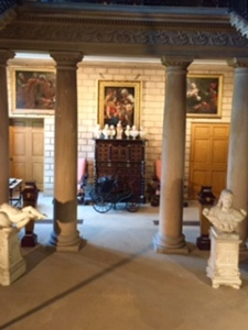 Burghley House sculpture room below Hell Staircase with antique pram