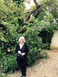 Ann beneath the very old mulberry tree which grew up and across Darwin's study window on the second floor of Down House. He refers t the tree in his notes