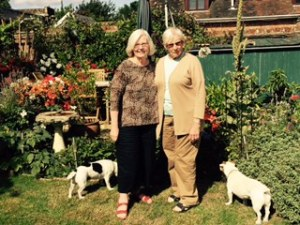 Ann and Joyce with Badger and Harvey in the garden at Forge House Frinsted