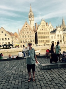 Ghent old town on the canal and Richard holding his latest
