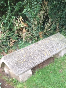 Simple grave of William, Jane, May and Jenny Morris in the graveyard of St George's Church in Kelmscott Village