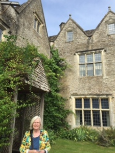 Ann at the entrance of Kelmscott Manor in the village of Kelmscott. Ann's quilting has been deeply influenced by the design work of William Morris so today was special for her