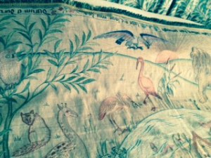Cot quilt with animal designs currently on loan to Kelmscott Manor