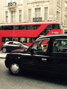 Icons of London traffic..black cabs and red double decker buses