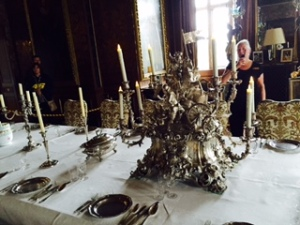 Massive solid silver candelabra on the State Room Dining Table commemorating a Thynne victory over Cromwell's ar,my