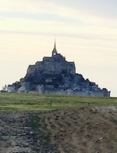 Mont St Michel monastery appearing over the horizon in early evening. An absolutely stunning sight.