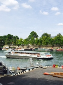 Busy river Seine activity in Paris summer