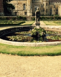Penshurst Place oval pond well stocked with fish in the centre of the formal parterre garden