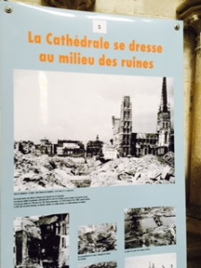 Display showing the extent of WW11 damage in Rouen with the Cathedral relatively unscathed whilst all around is flattened.