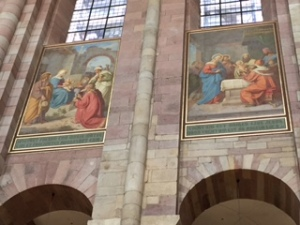 Two of a large group of Speyer cathedral frescoes high above the nave.