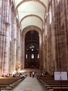Speyer Cathedral interior ..very plain, no stained glass, very little statuary, modern communion tables.