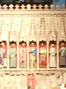 St Albans close up of colourful figures on the rood screen