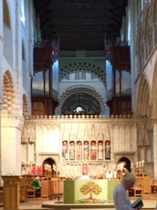 Interior of St Albans showing the solid stone rood screen effectively dividing the interior into two halves. The 9.30am service was conducted on this side with modern furniture in the sanctuary and a warm close knit community.