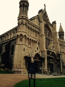 West face of St Albans Abbey Cathedral north of London. The stonework is under restoration