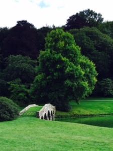 Stourhead House gardens with bridge over the lake