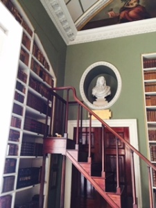 Stourhead House library shelf staircase and one of two busts of Milton