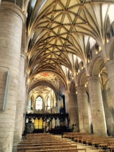 Romanesque Tewksbury Abbey with its massive round columns and beautiful ceiling bosses