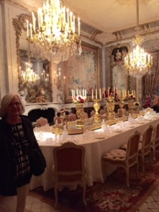 Ann eyeing of the silver service in one of the three dining rooms