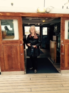 Ann on a boat! actually a boat severely anchored in three places for ever. Check the new coat!