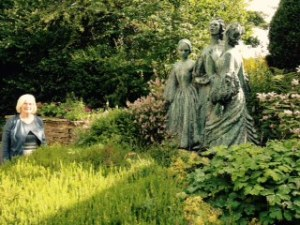 Sculpture of the three surviving sisters in the rear garden of the Parsonage