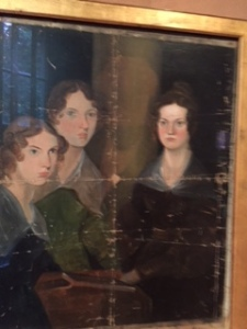 The three surviving Bronte sisters painted by brother Branwell  (he was in the middle and his shadowy outline remains.) This precious portrait now in the London Portrait Gallery