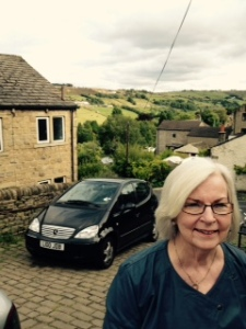 Ann still smiling after climbing the hill to the Bronte Parsonage