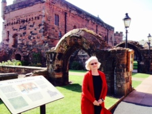 Ann at the door of the old abbey with the chapter house beyond