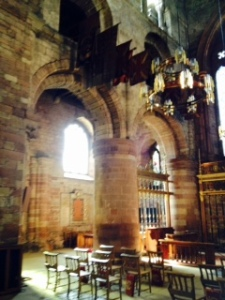 The Norman nave of Carlisle Cathedral with large round columns and round arches remiiscent of Tewksbury C12th