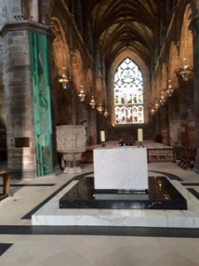 Modern communion table in the very centre of St Giles Cathedral. Stark, simple and highly effective
