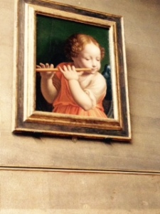 Luini Angel child playing the flute. Never really thought of child angels...