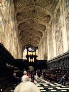 Interior view of Kings College Chapel as you enter with the organ loft dominating the view forward