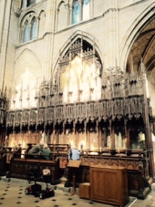 Ancient choir stalls and misericords in the old quire behind the rood screen