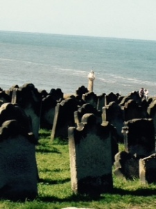 Whitby lighthouse beneath graveyard of St Marys church